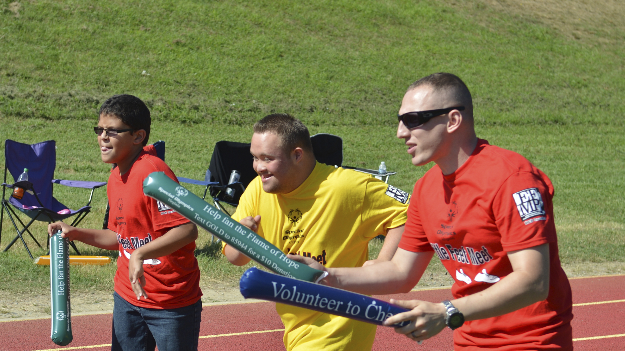 Special Olympics participant runs during a track and field event.