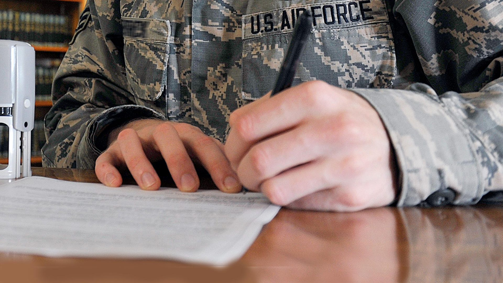 Service member filling out paperwork