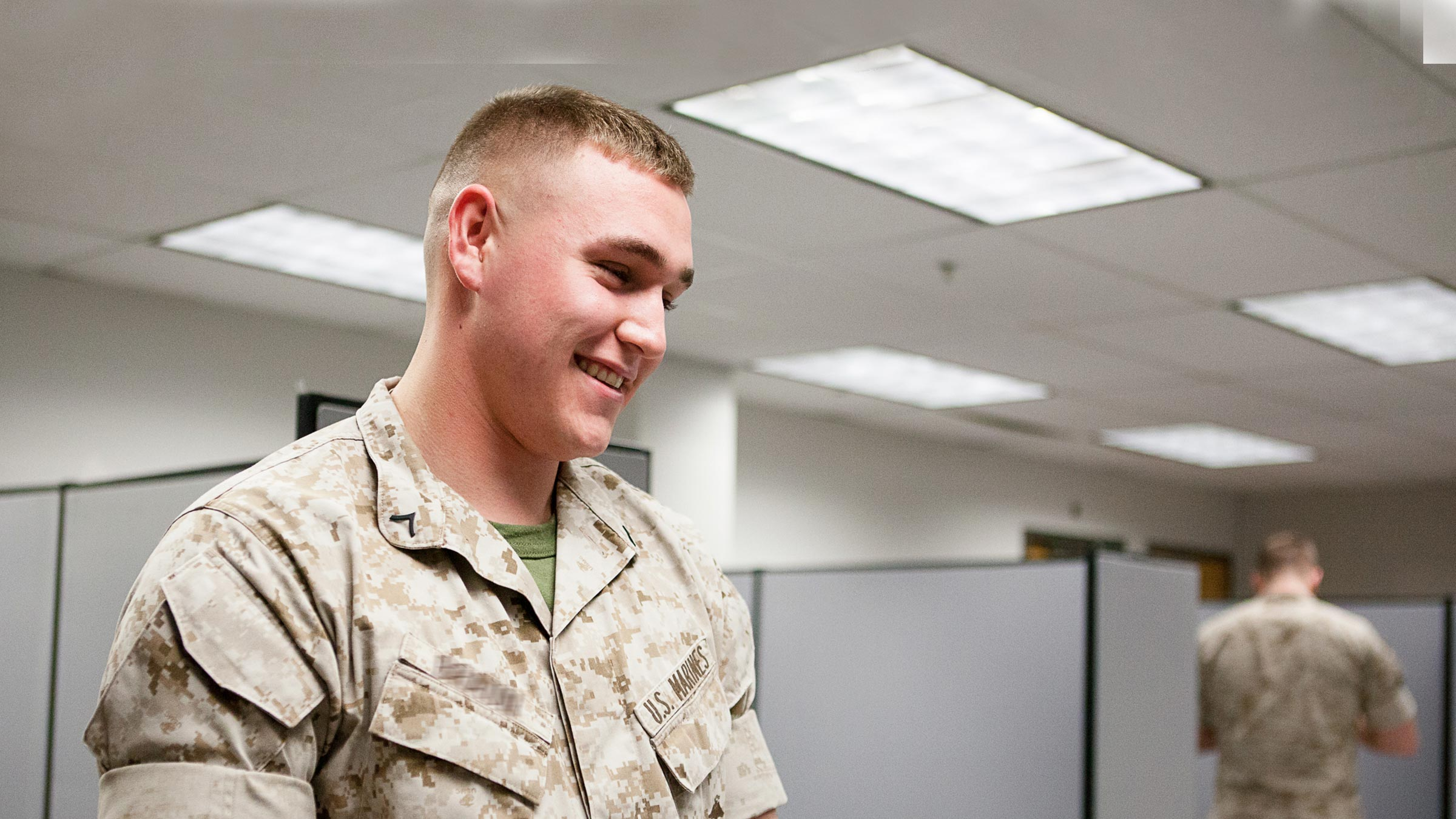 A marine talks with staff at a tax assistance center.