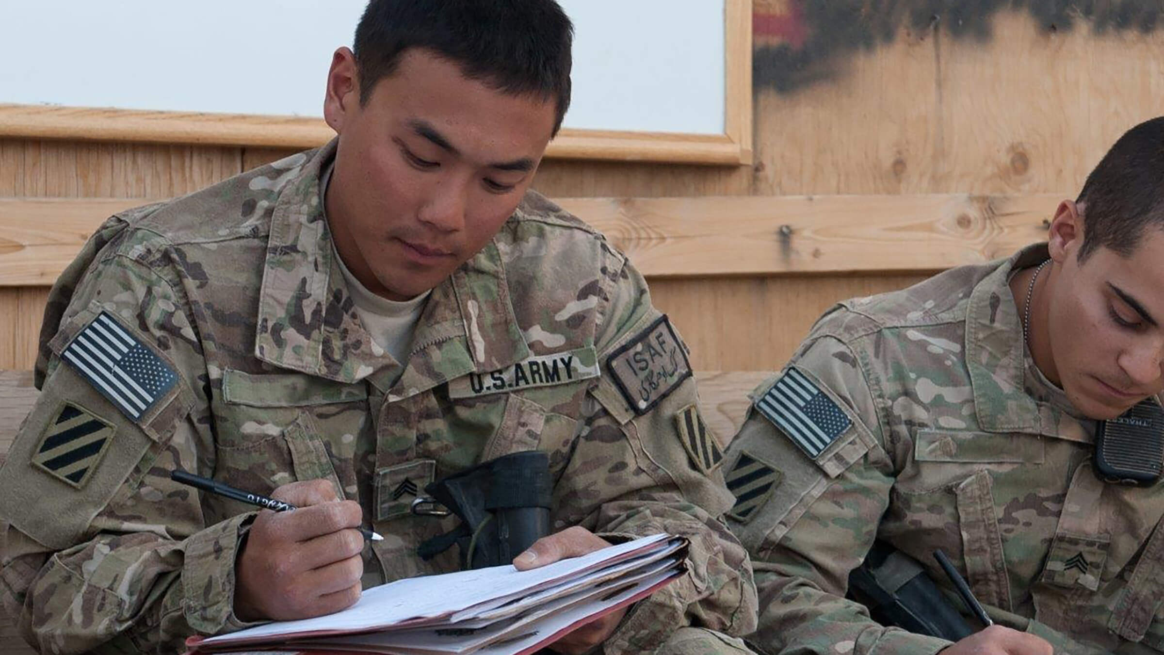 Service member taking notes
