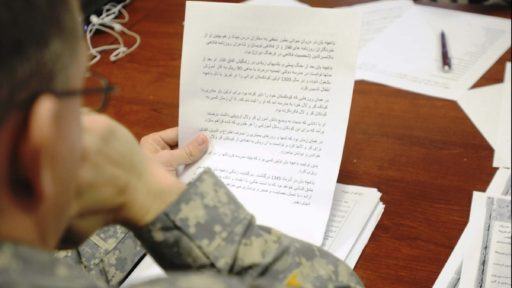 A linguist practices his Arabic translation skills
