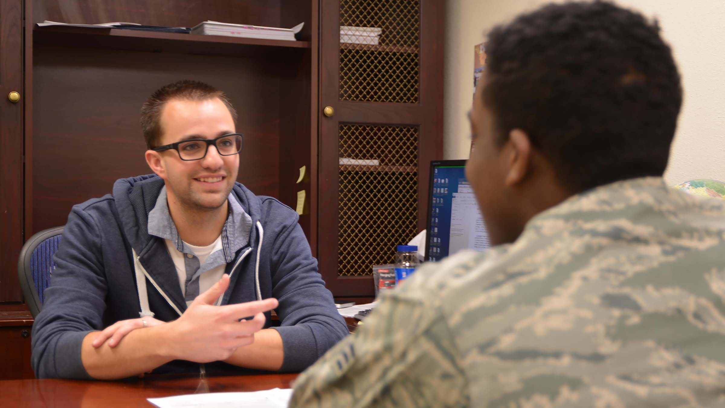 Volunteer helps service member with taxes