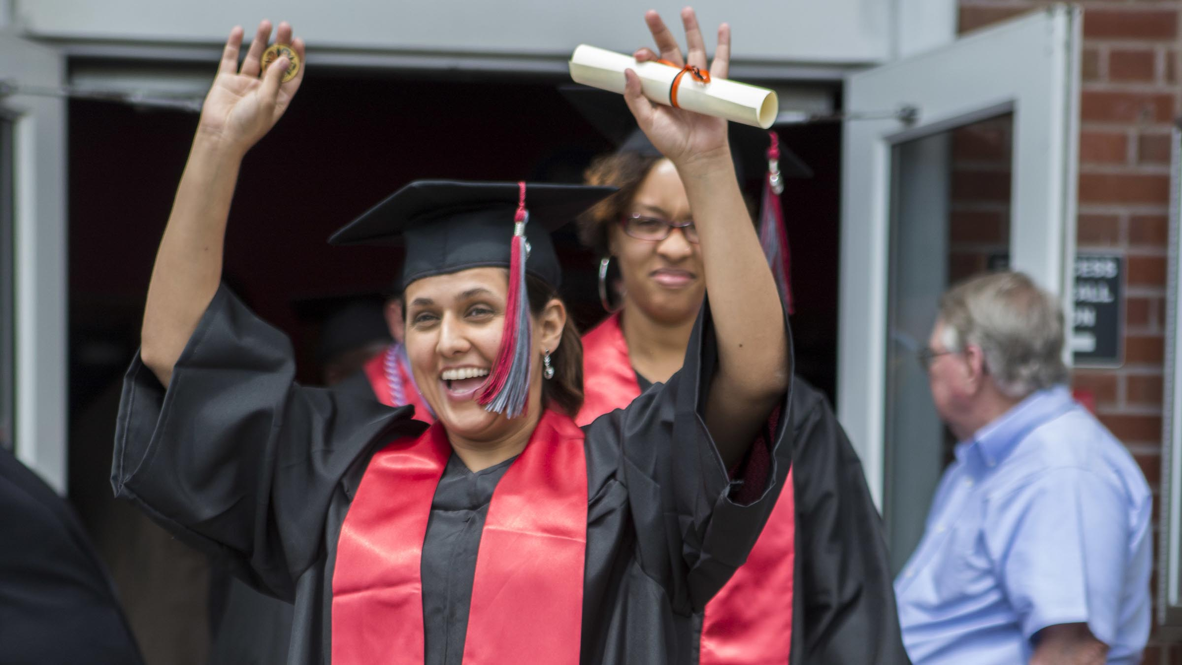 Graduating woman excited with diploma