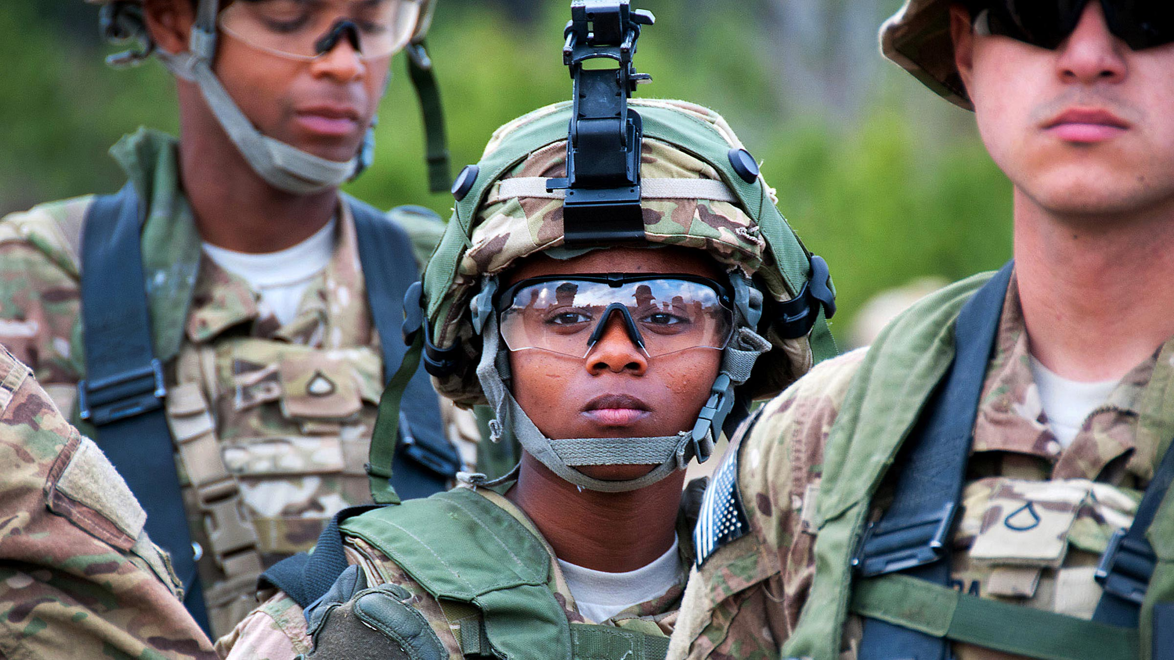 Service member with ballistic glasses looks into the distance