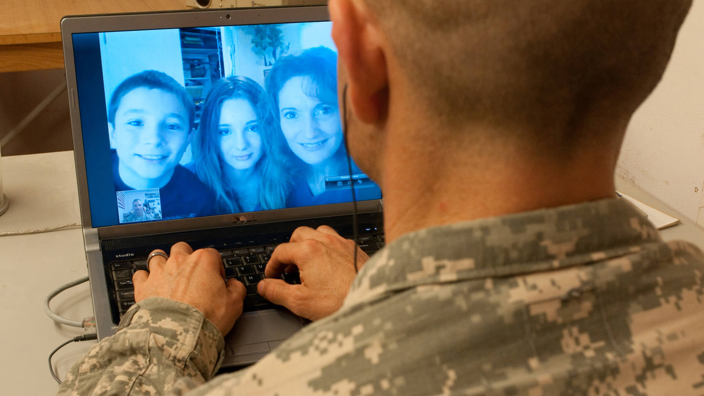 Service member on video chat with family.