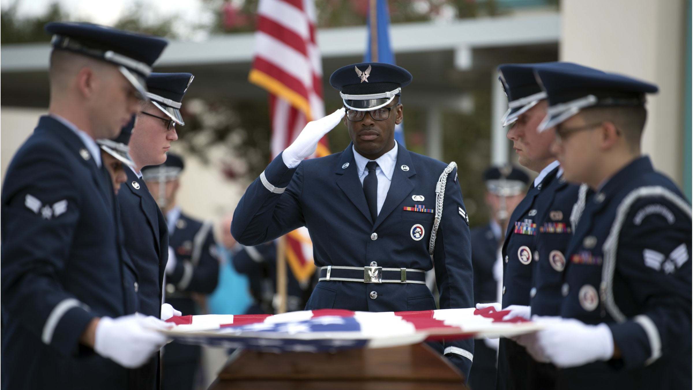 Air Force honor guard performs military honors service.