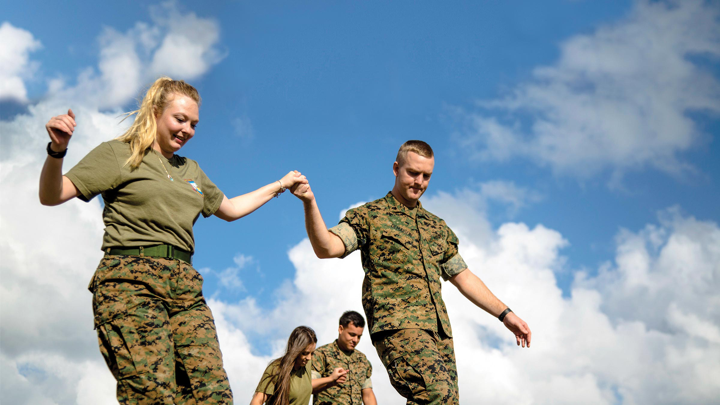 Service member couple holding hands