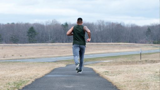 Military male jogging outside
