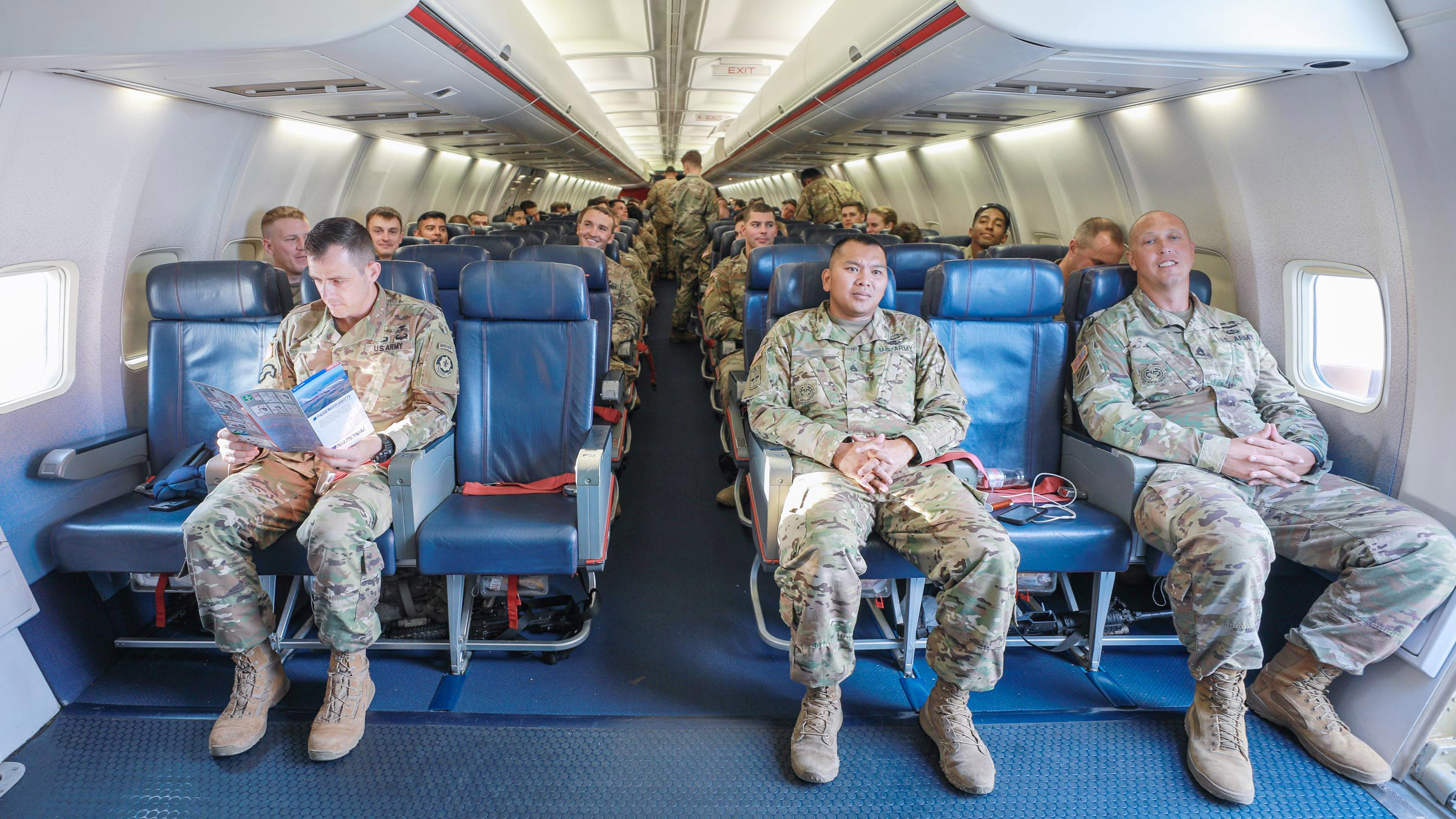 Service members sitting in a plane
