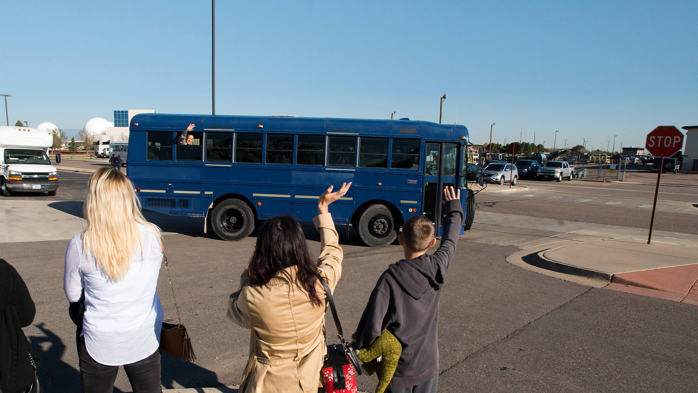 Family waves at leaving service member