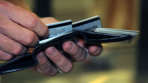 hands holding wallet with credit cards