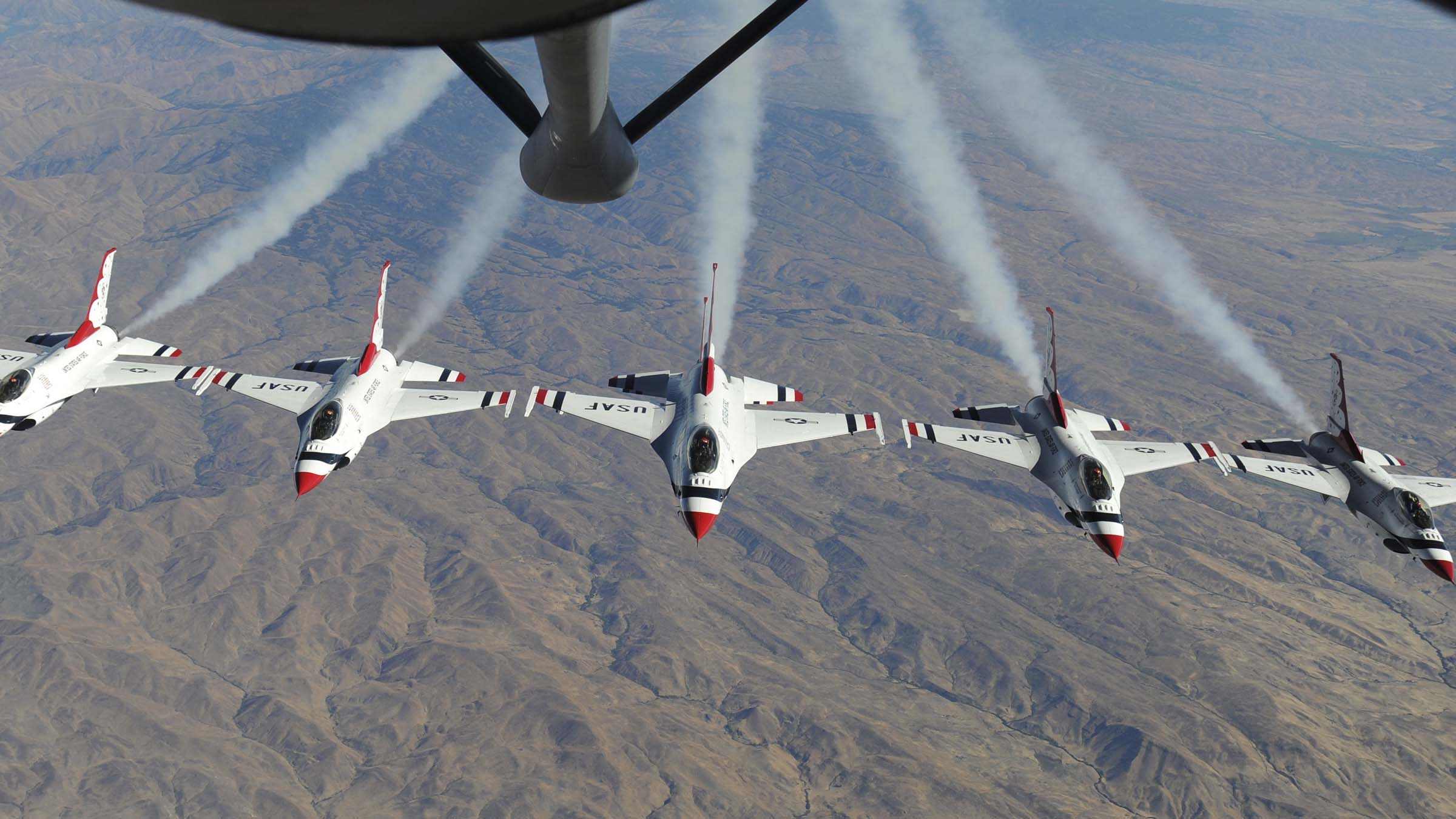 F-16 falcons fly in a row over mountains