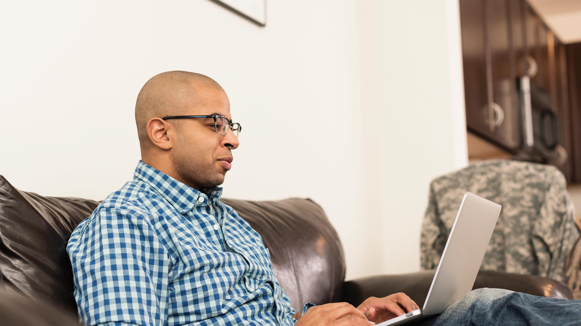 Man at home on his laptop