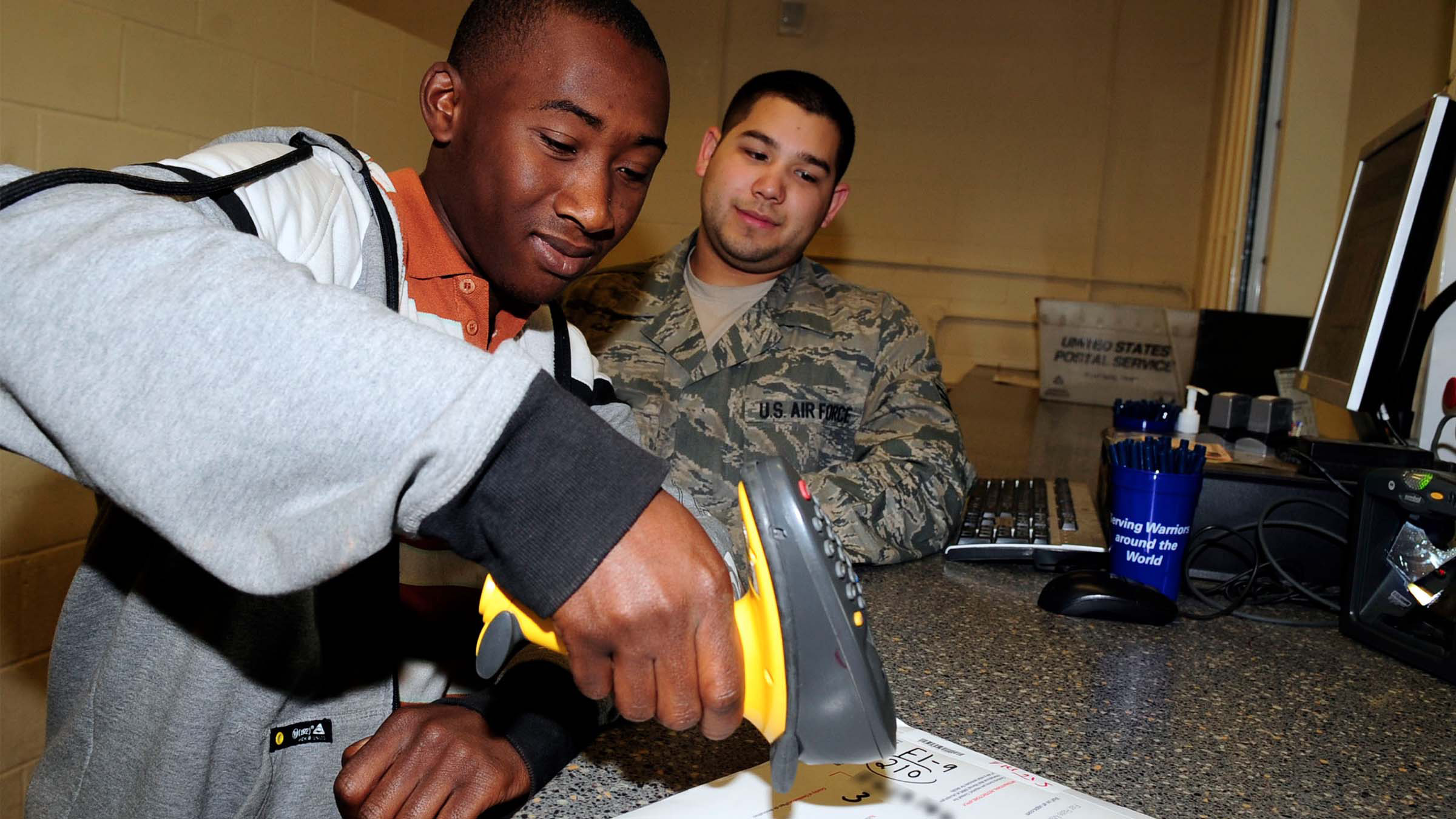 Man working with service member