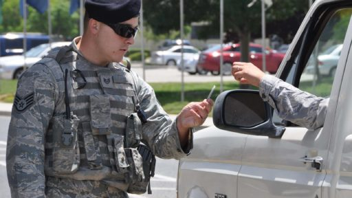 Military male checking badge