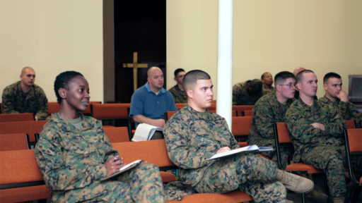 Service members sit in classroom