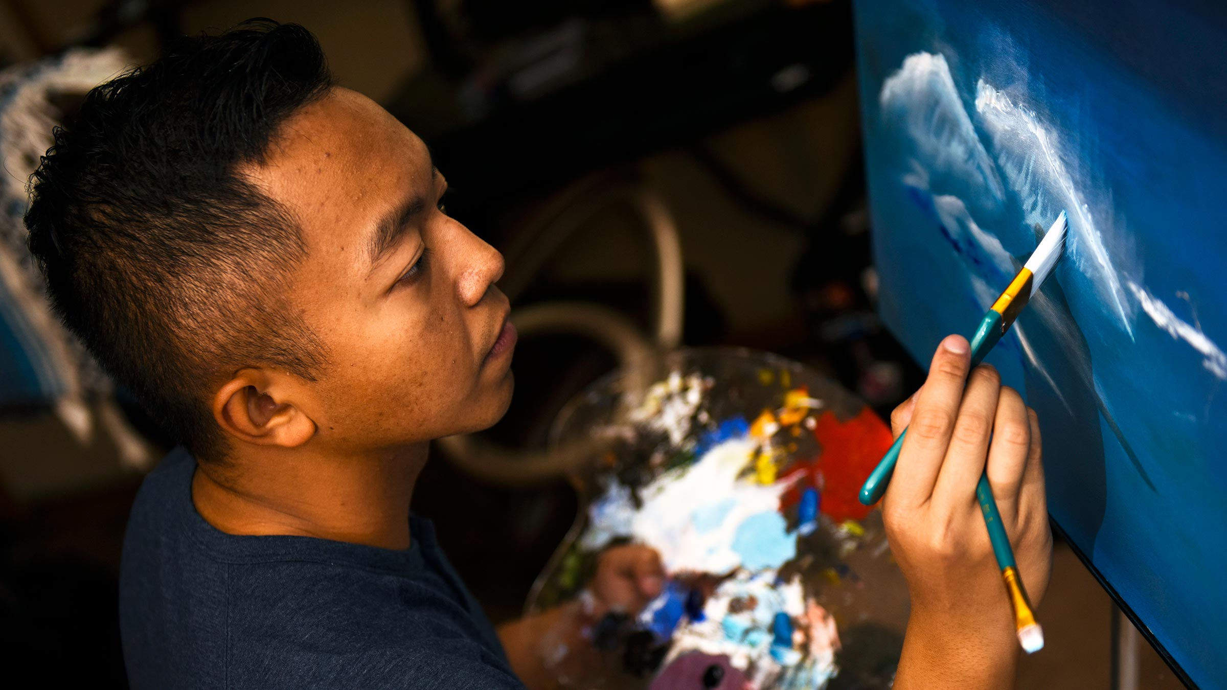 Service member is painting.