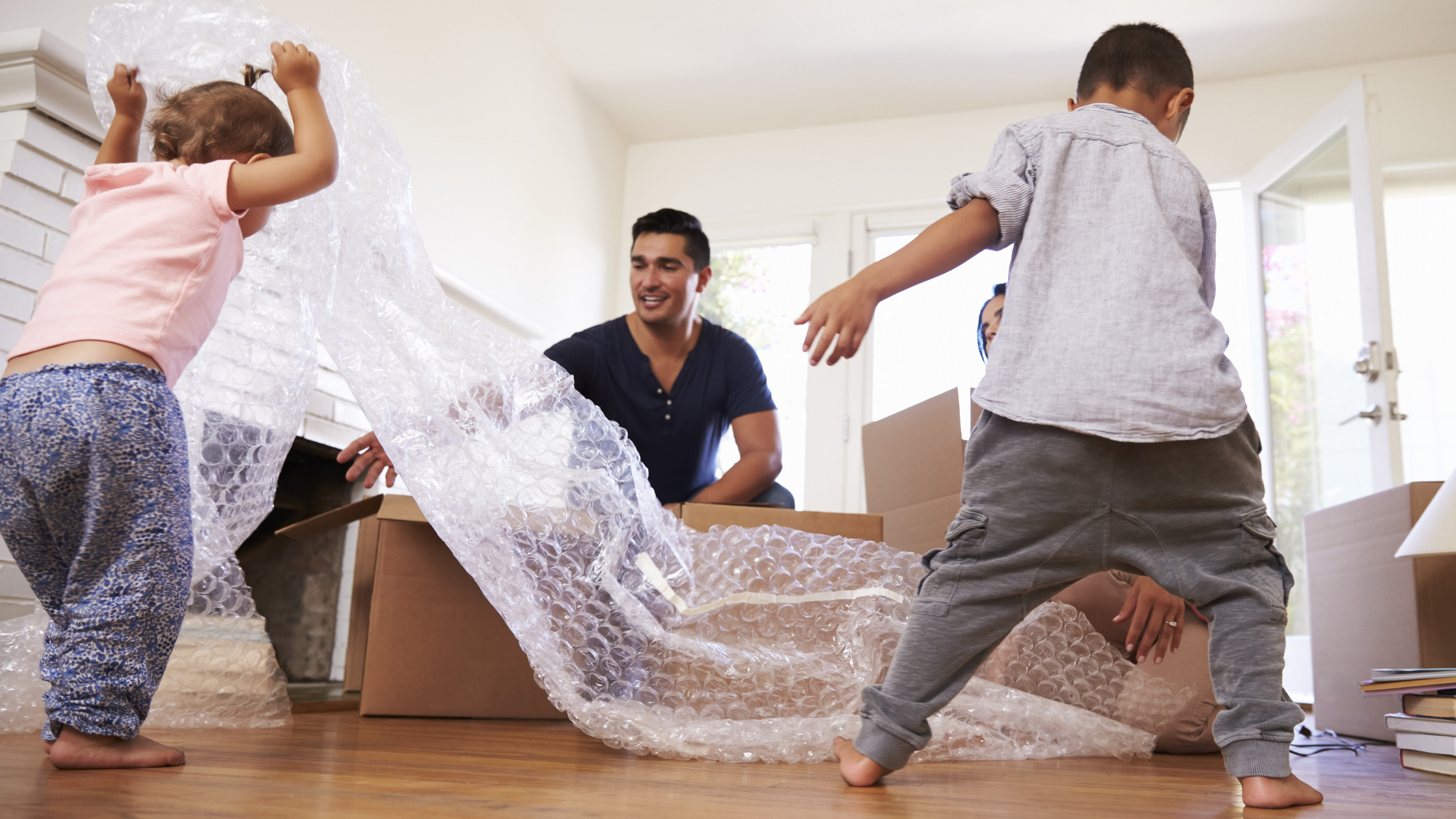 Kids playing with bubble wrap