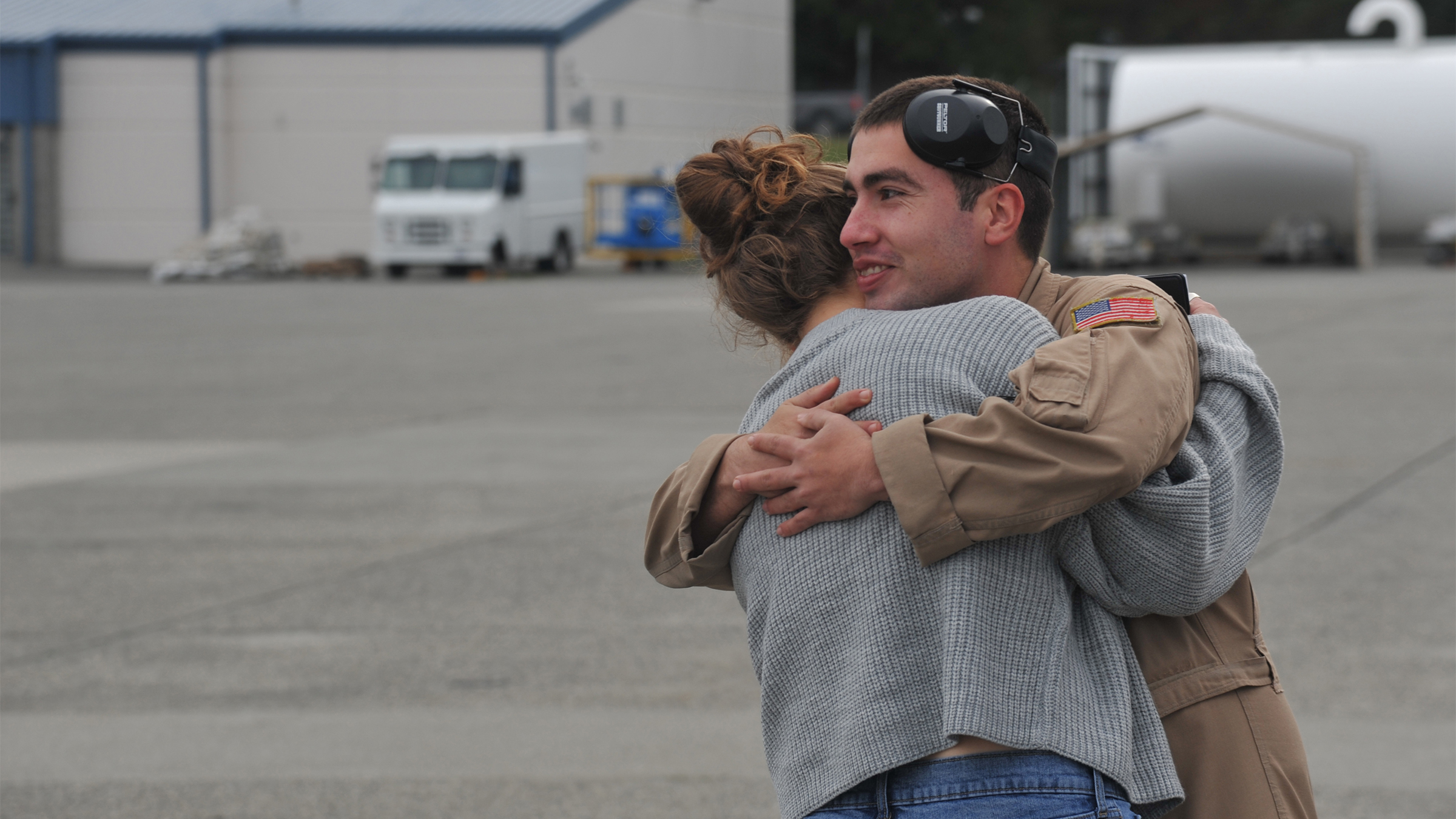 A sailor hugs a loved one after returning from deployment.