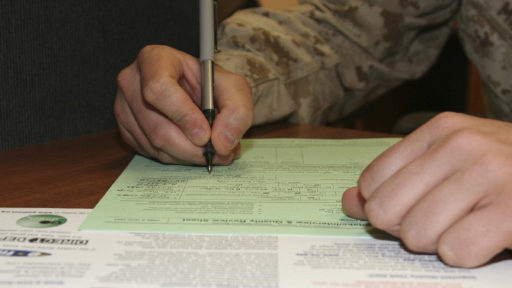 Service member filling out tax form