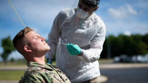 A service member gets tested for COVID-19