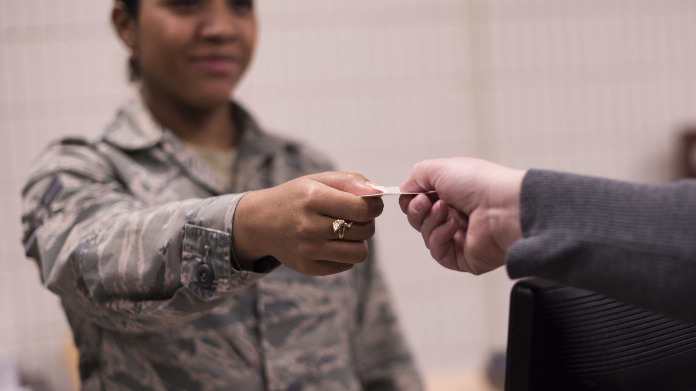 Service member receiving an ID card
