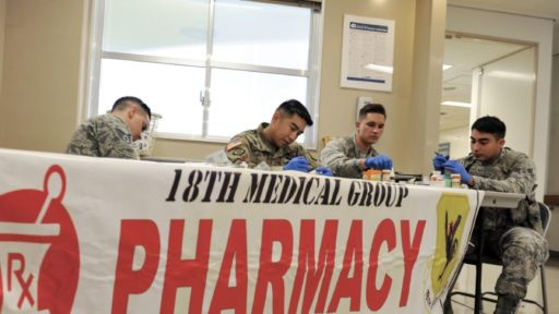 Service members at medical group pharmacy table