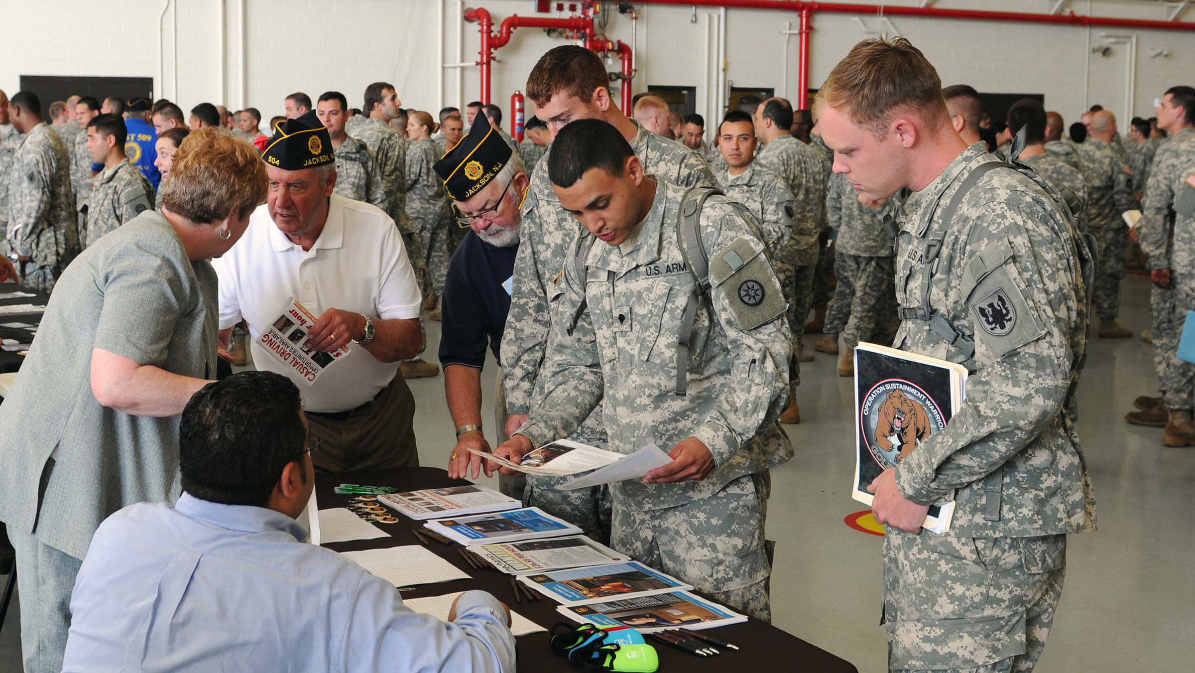 Service members learning about programs