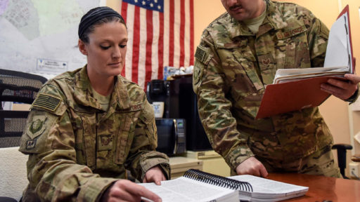 Service members reviewing documents