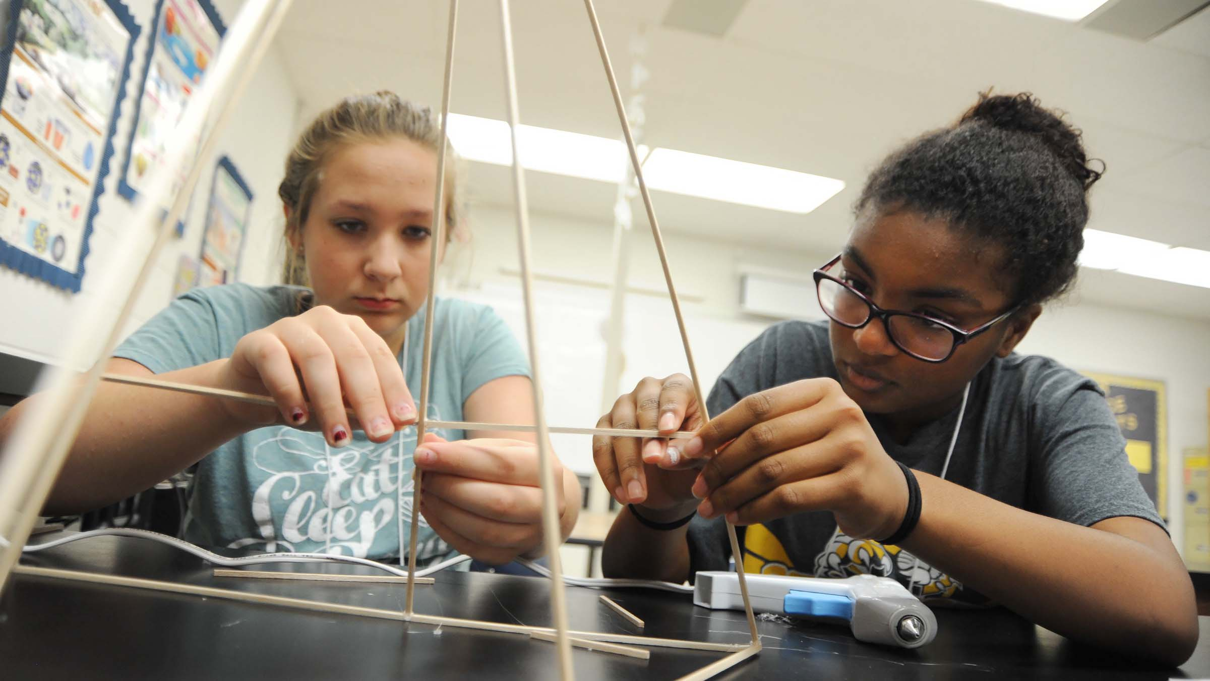 teenagers work together on a craft project