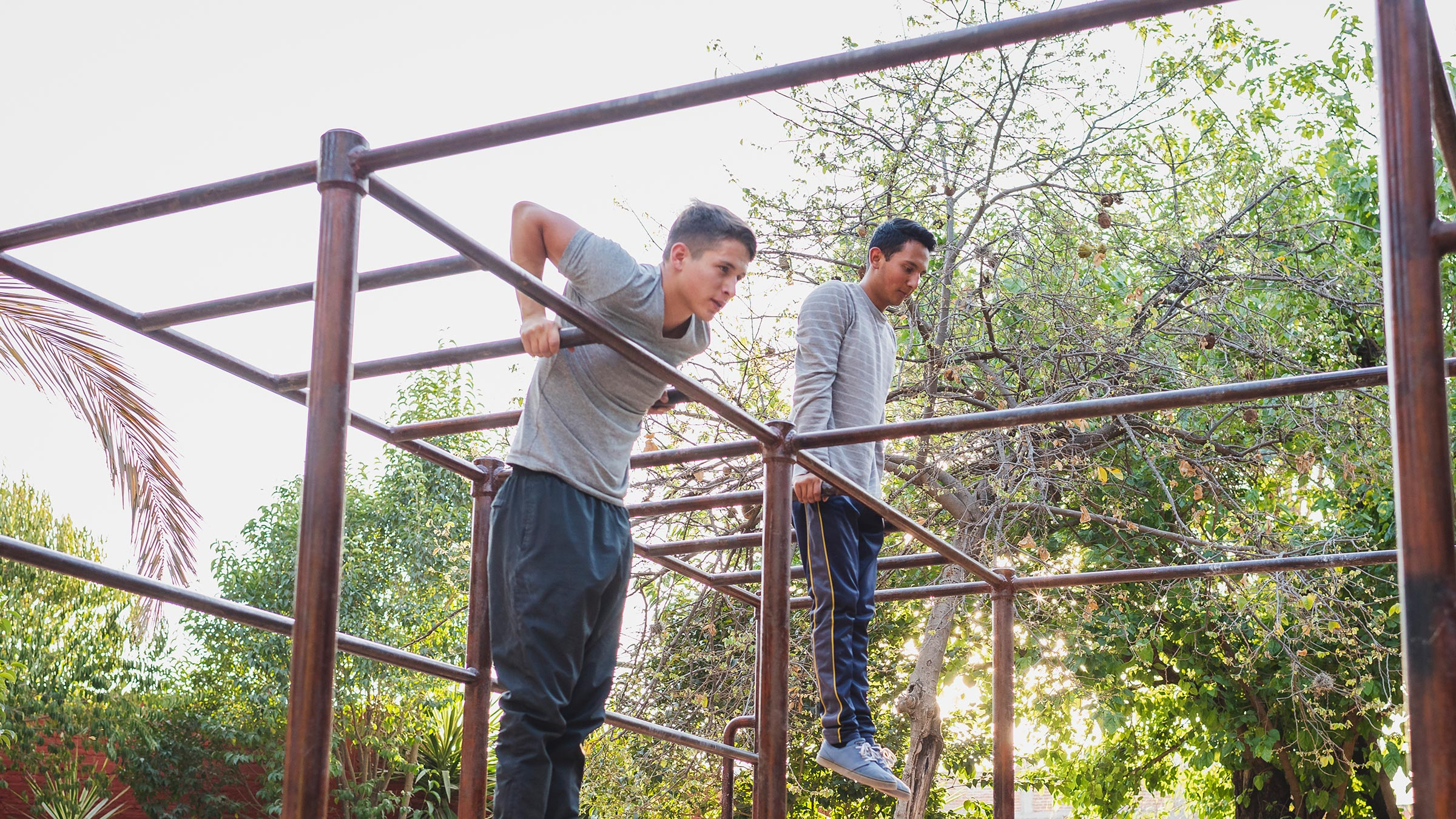 Two men working out outdoors
