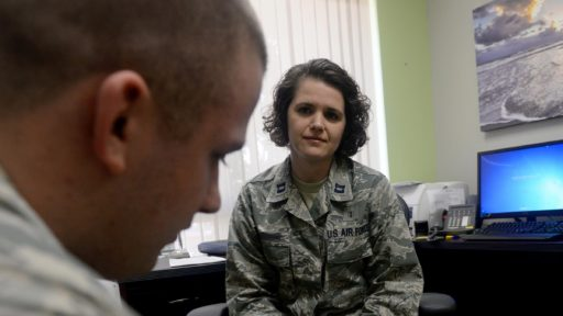 Woman listening to service member