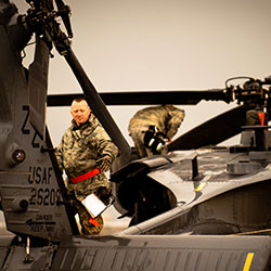 Service member exiting helicopter