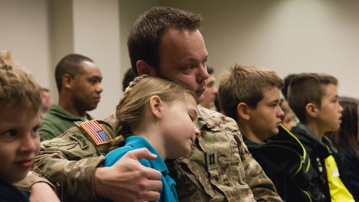 Soldier comforts daughter