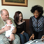 Parents with baby and counselor