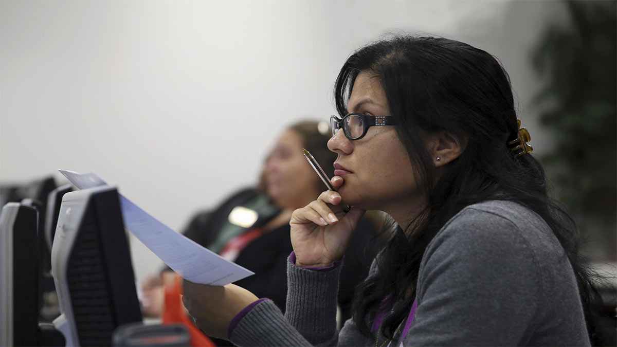 Woman taking notes during class