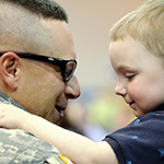 A service member with their child