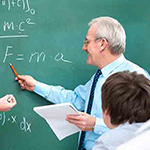 Teacher pointing at a chalkboard