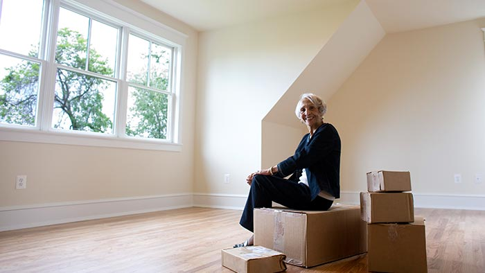 A woman sitting on moving boxes