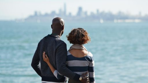 couple looks out over bay