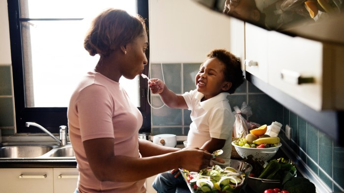 A mother a child cooking in the kitchen