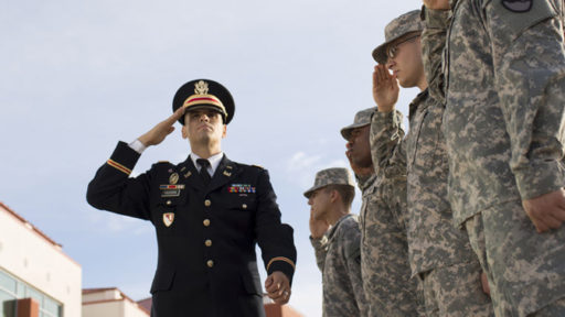 an officer is saluted by enlisted service members
