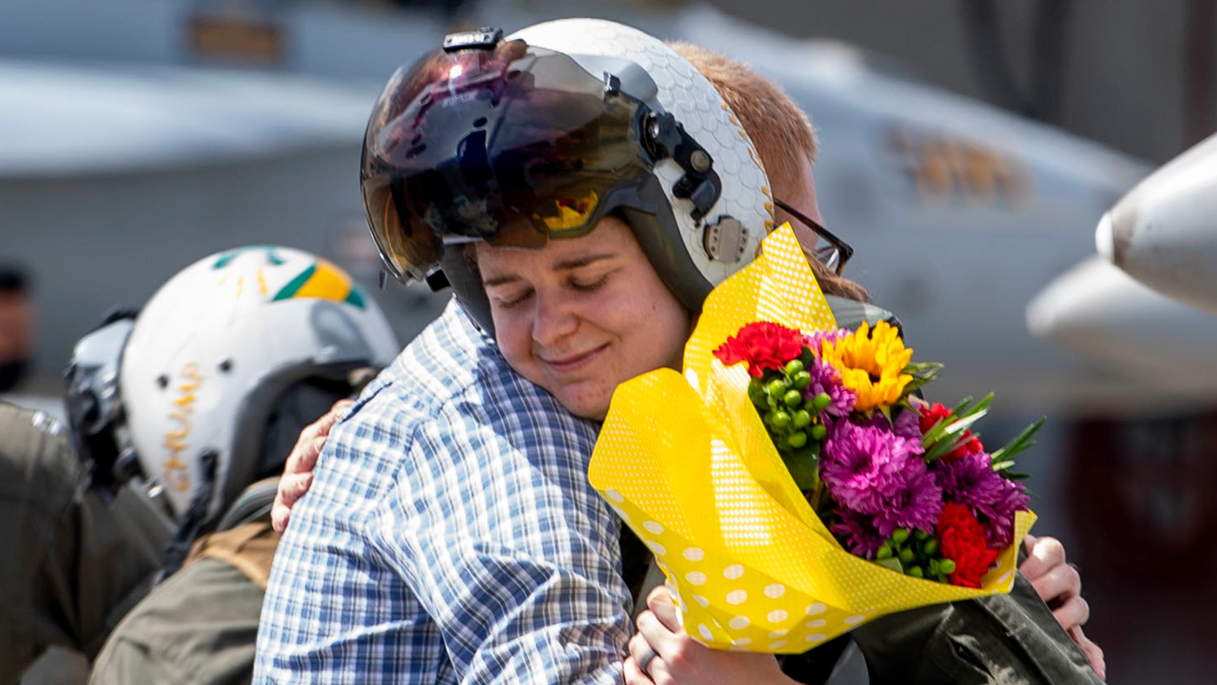 A service member is hugged after returning from deployment