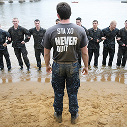 Naval Academy Midshipmen in the water.