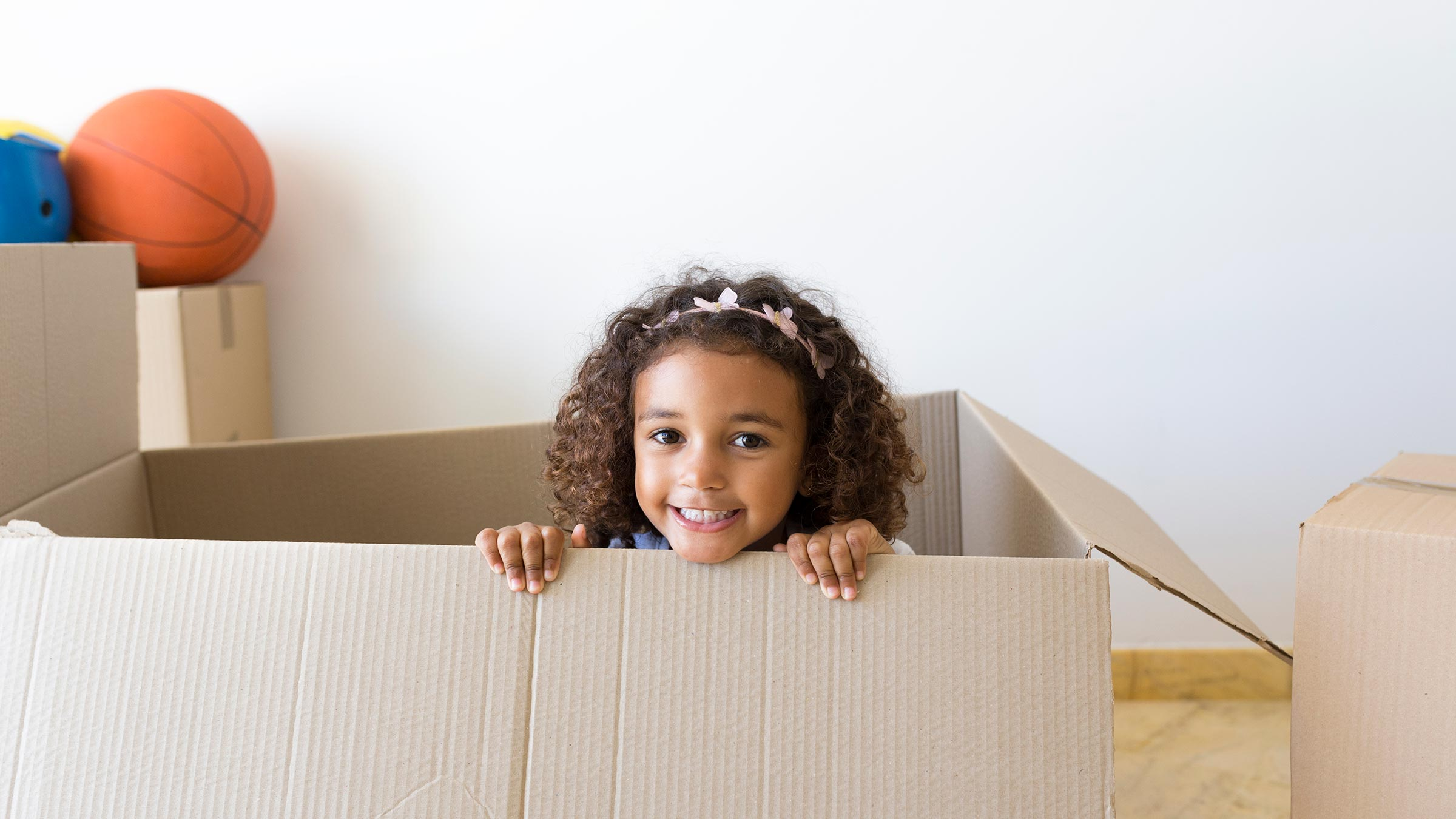 child playing in moving box