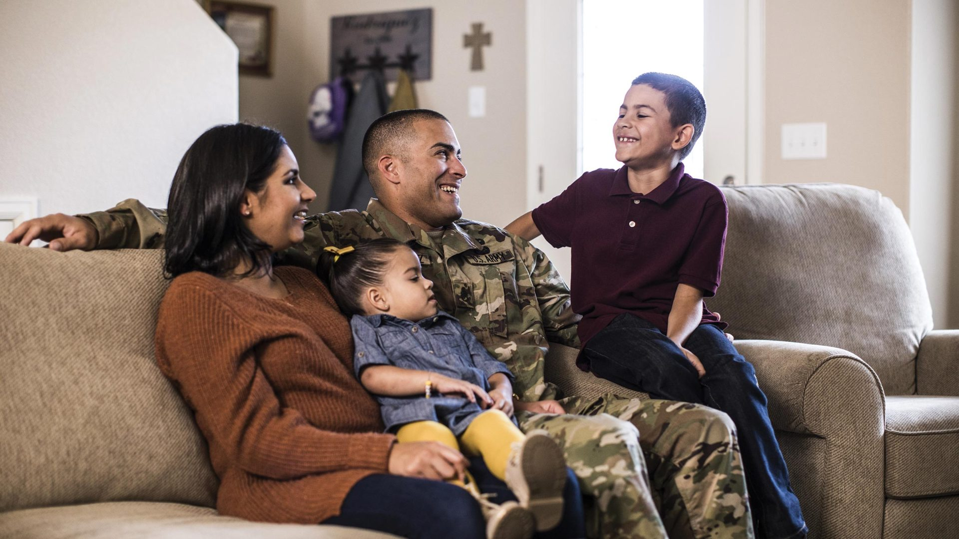 Military family sitting and laughing together at home