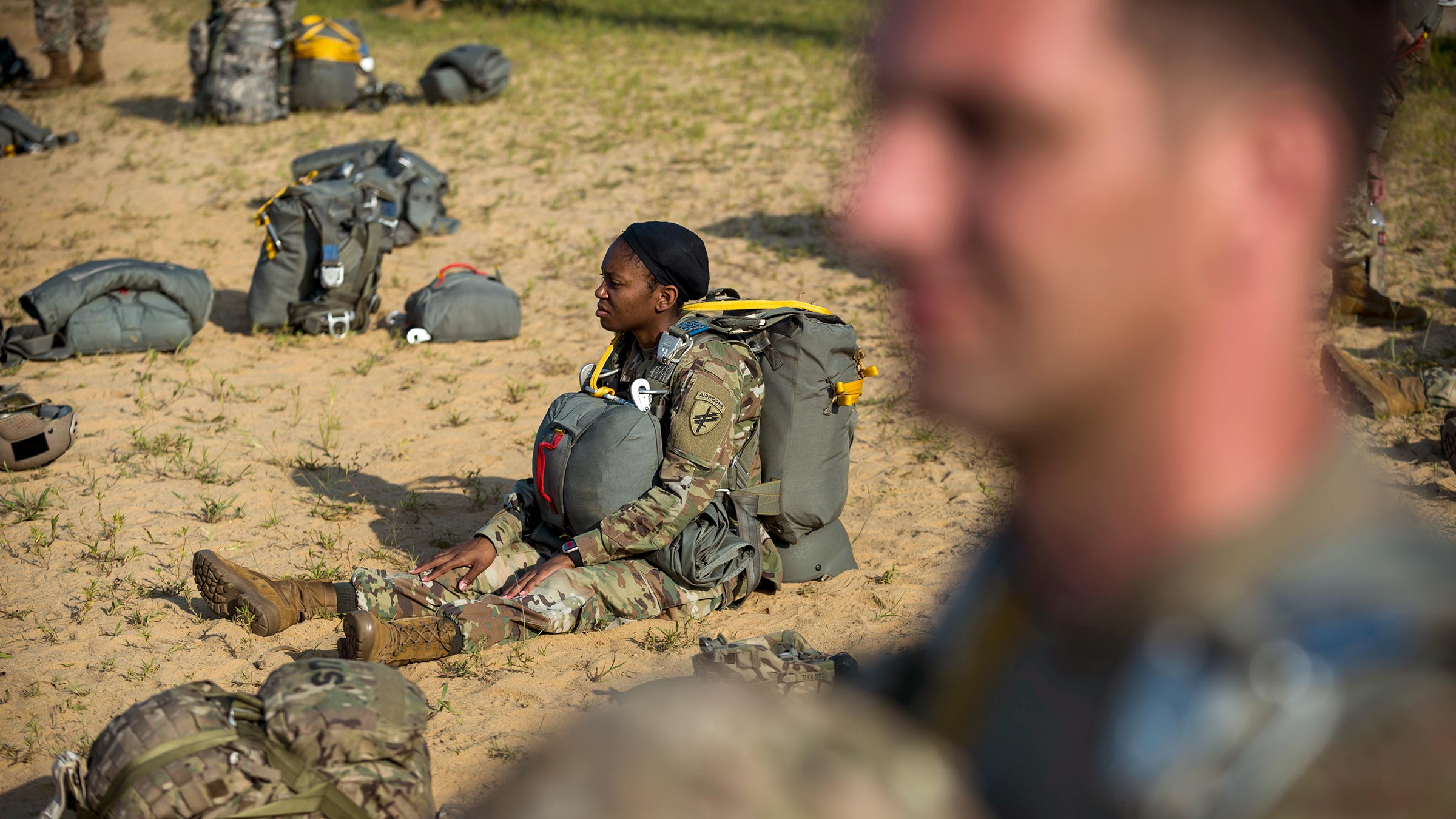 a service member waits for a helicopter jump