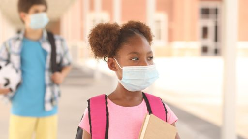 Two students with masks physically distancingImage source: https://www.gettyimages.com/detail/photo/african-descent-girl-on-school-campus-mask-for-royalty-free-image/1251048576?adppopup=true