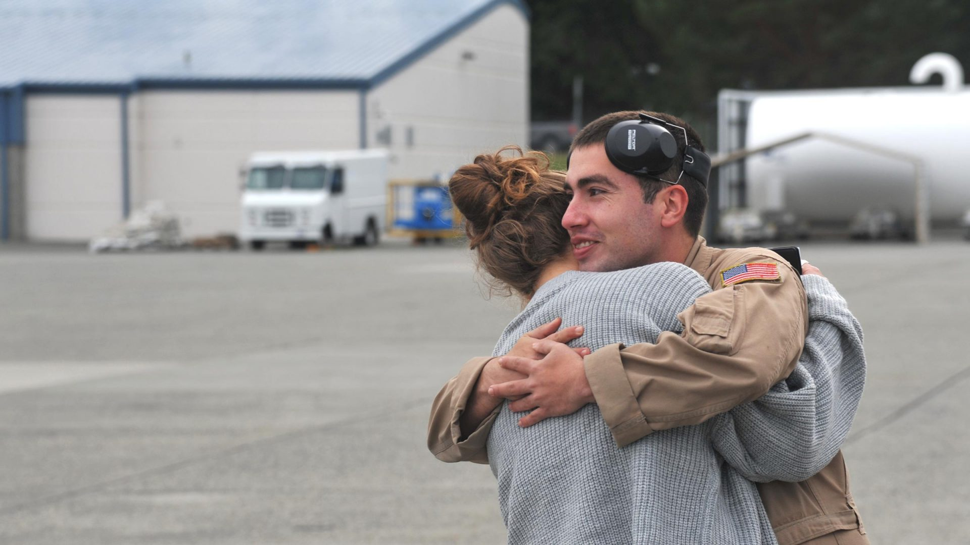 A sailor hugs a loved one after deployment