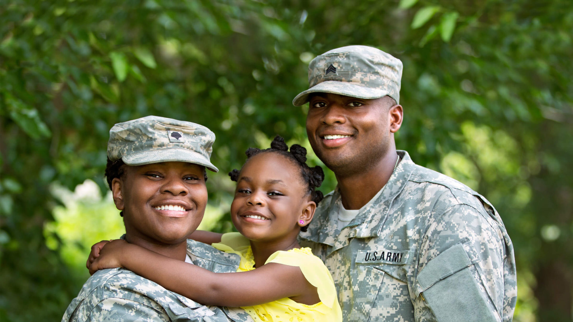 Service member with wife and daughter